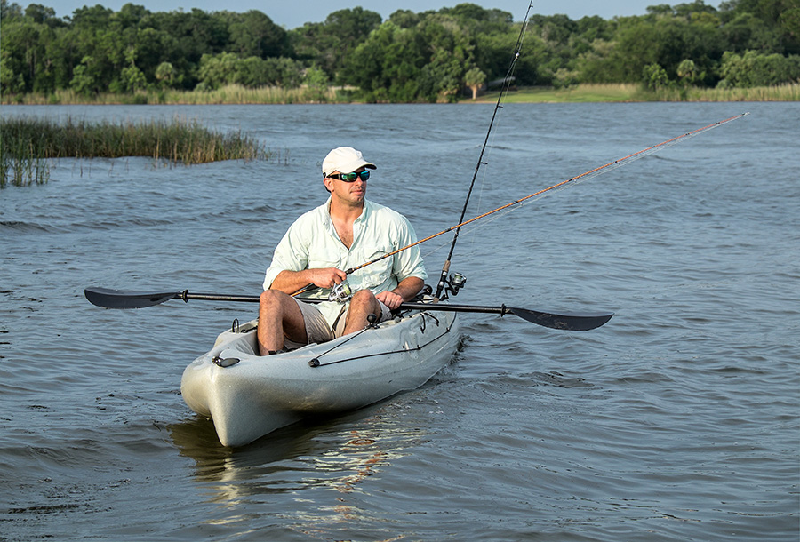 Best Fishing Kayak Man with two rods in kayak